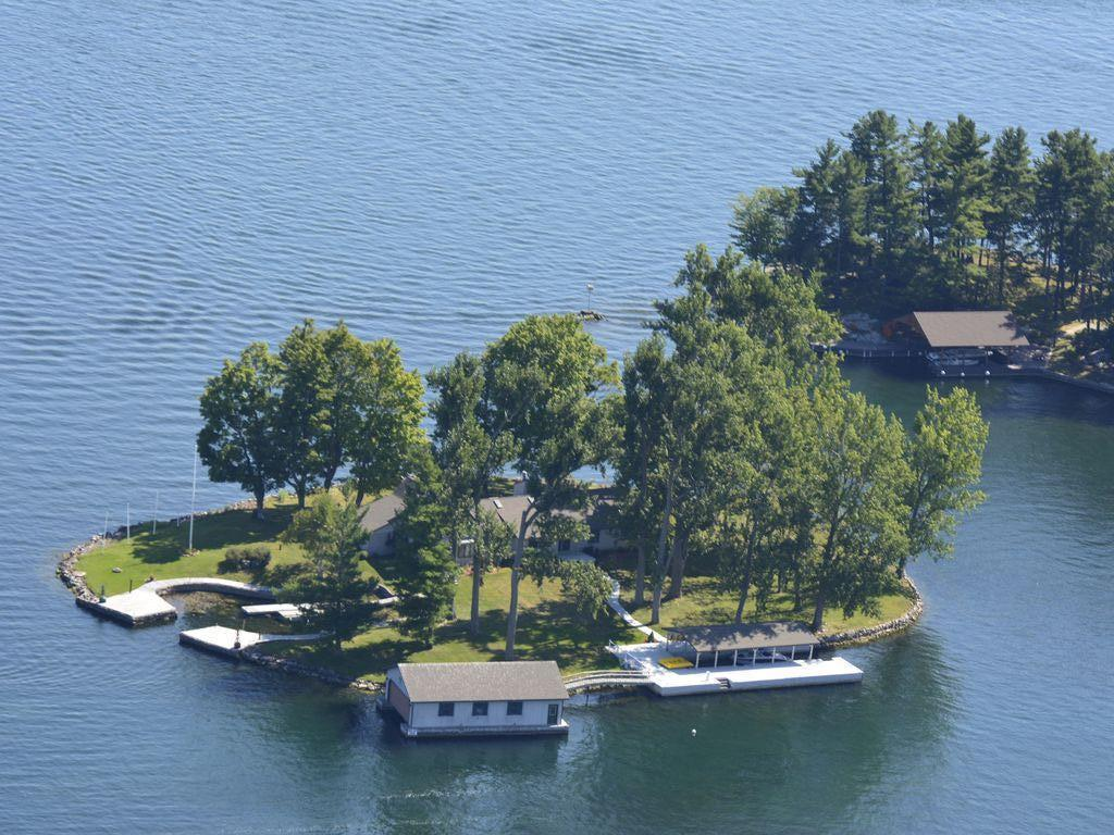 Back side of Belle Island with dock and boat house