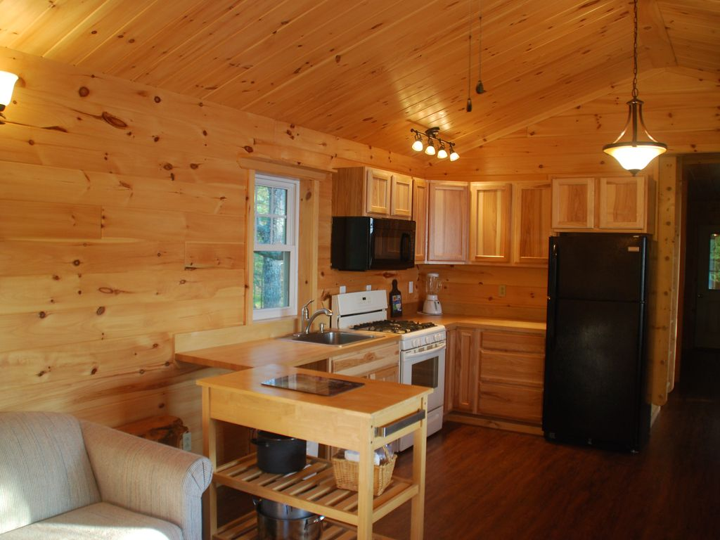 Enjoy preparing your meals in a new kitchen. Side porch has