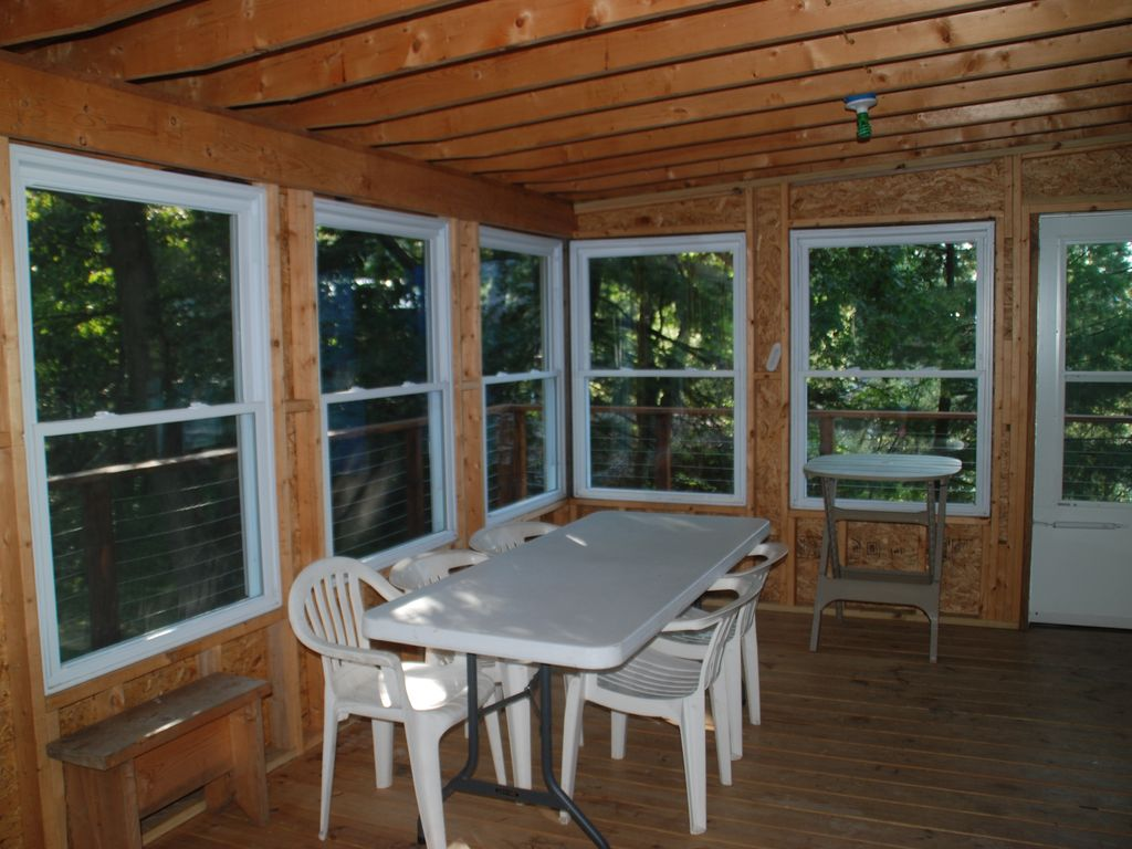 Screened in porch that has view of Island and shipping chann