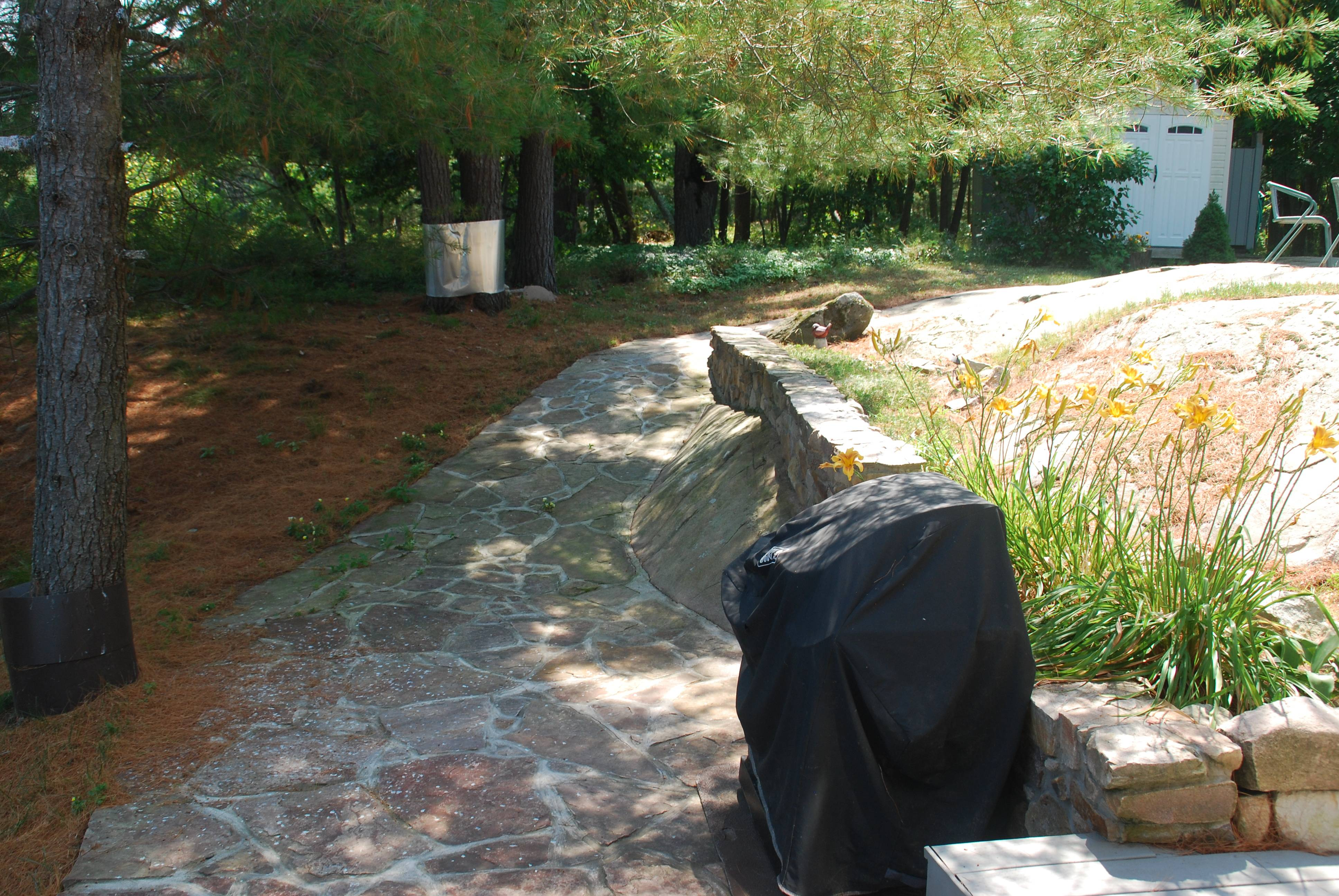 Stone path leading up to fire pit and outdoor shower