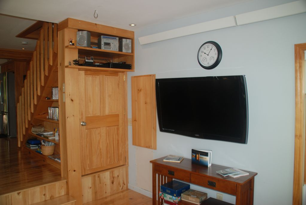 Living room; large screen TV, stereo, DVD player, games